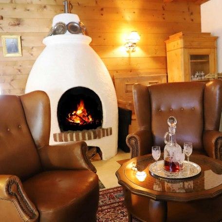 gemütliche Sitzecke mit offenem Kamin, © im-web.de/ Alpenregion Tegernsee Schliersee Kommunalunternehmen